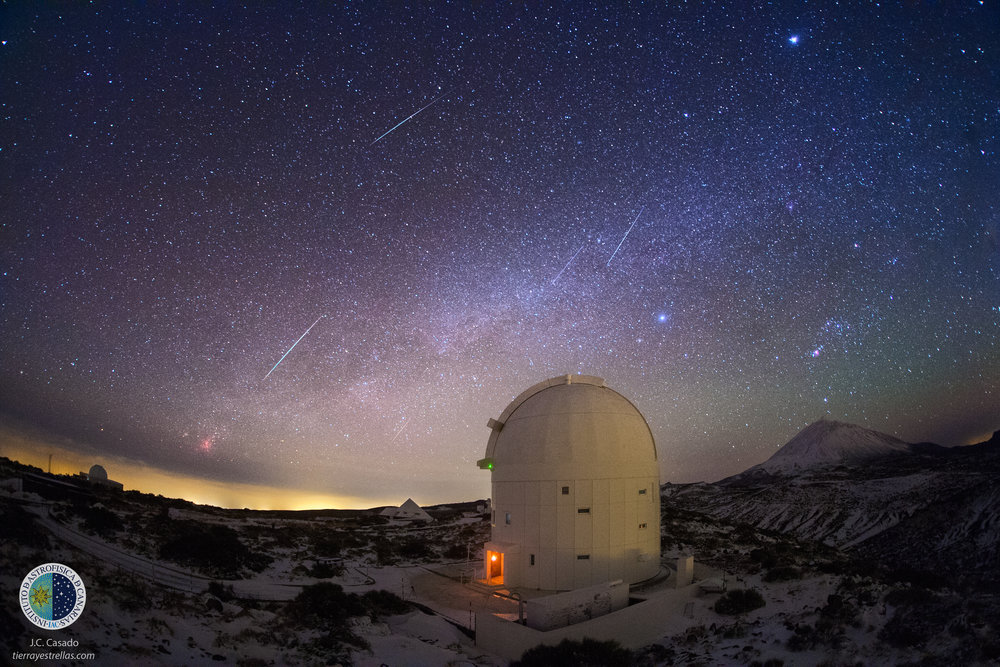 Several Geminid meteors seen from the Observatorio del Teide (IAC), Tenerife, Spain, in the morning of 14 June 2013, at about 05:30 GMT. The telescope in the foreground is ESA's Optical Ground Station. Above is the Orion constellation; the brightest spot at the top of the image is Jupiter. Image credit:  StarryEarth via Flickr  is CC licensed  CC BY-NC 2.0