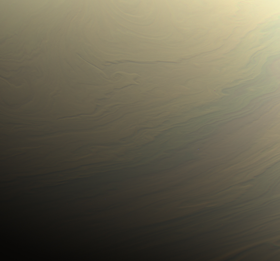NASA's Cassini spacecraft gazed toward the northern hemisphere of Saturn to spy subtle, multi-hued bands in the clouds there.  Image credit : NASA/JPL