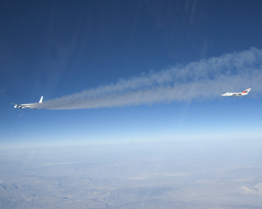 Flying some 500 feet behind NASA's DC-8 flying laboratory, NASA Langley's heavily instrumented HU-25 Falcon measured chemical components of the exhaust streaming from the DC-8's engines burning a 50/50 mix of conventional jet fuel and a plant-based biofuel during the 2013 ACCESS biofuels flight tests. Image credit: NASA/Lori Losey
