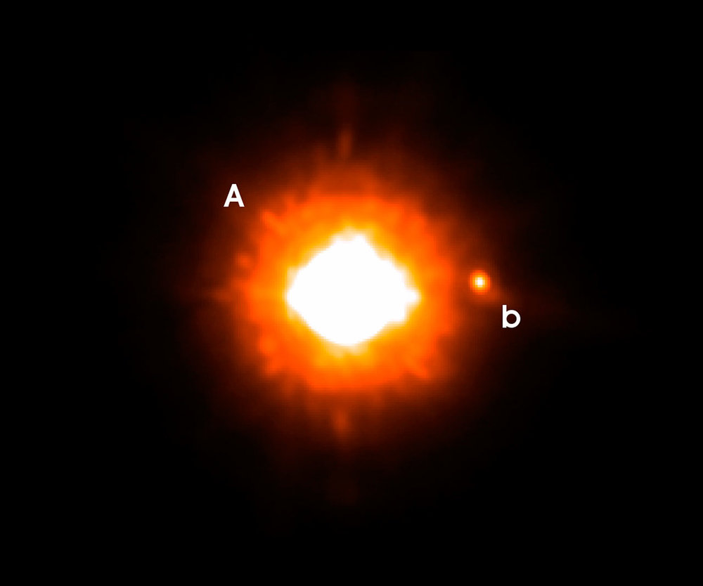 VLT NACO image, taken in the Ks-band, of GQ Lupi. The feeble point of light to the right of the star is the newly found cold companion. It is 250 times fainter than the star itself and it located 0.73 arcsecond west. At the distance of GQ Lupi, this corresponds to a distance of roughly 100 astronomical units. North is up and East is to the left.   Credit:    ESO