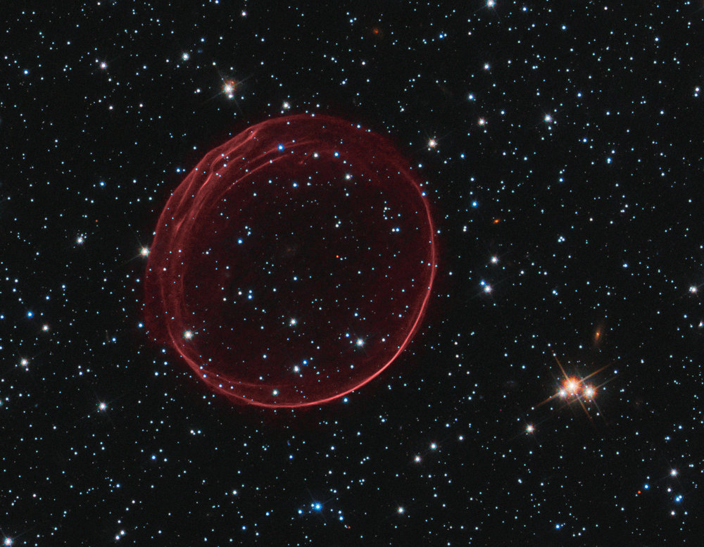 A delicate sphere of gas, photographed by NASA's Hubble Space Telescope, floats serenely in the depths of space. The pristine shell, or bubble, is the result of gas that is being shocked by the expanding blast wave from a supernova. Image credit:  NASA ,  ESA , and the  Hubble Heritage  Team ( STScI / AURA ); Acknowledgment: J. Hughes (Rutgers University)