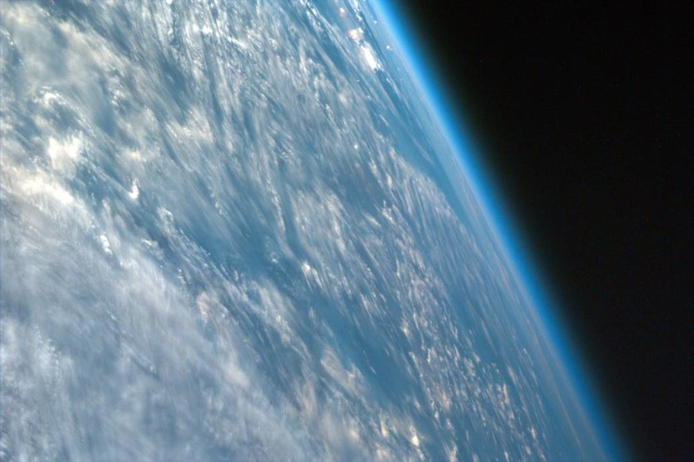 Most ISS images are nadir, in which the center point of the image is directly beneath the lens of the camera, but this one is not. This highly oblique image of northwestern African captures the curvature of the Earth and shows its atmosphere. Image credit:  NASA/JPL/UCSD/JSC
