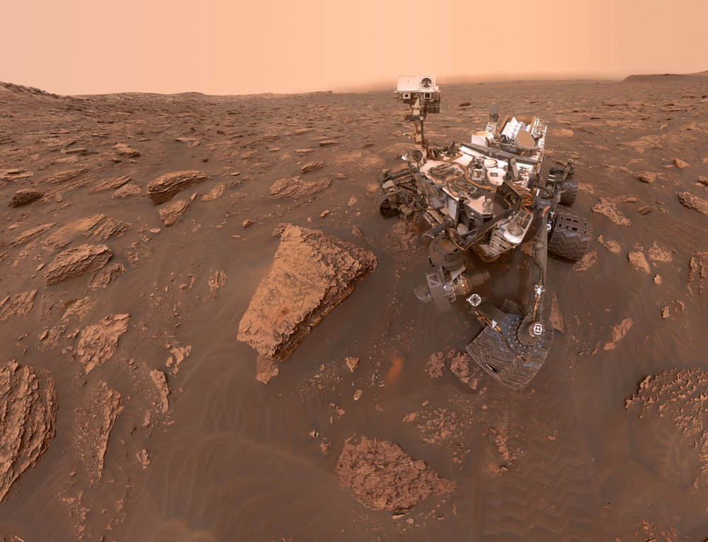 A self-portrait taken by NASA's Curiosity rover taken on Sol 2082 (June 15, 2018). A Martian dust storm has reduced sunlight and visibility at the rover's location in Gale Crater. Credit:  NASA/JPL-Caltech/MSSS