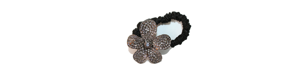 This is a fantastic, sparkling ponytail holder and here I am showing you how easy it is to wear as a classic ponytail. You can find it here  http://www.reneerivera.com/couture/silk-ponytail-holder-with-crystal-flower-black?category=Ponytail%20Holders