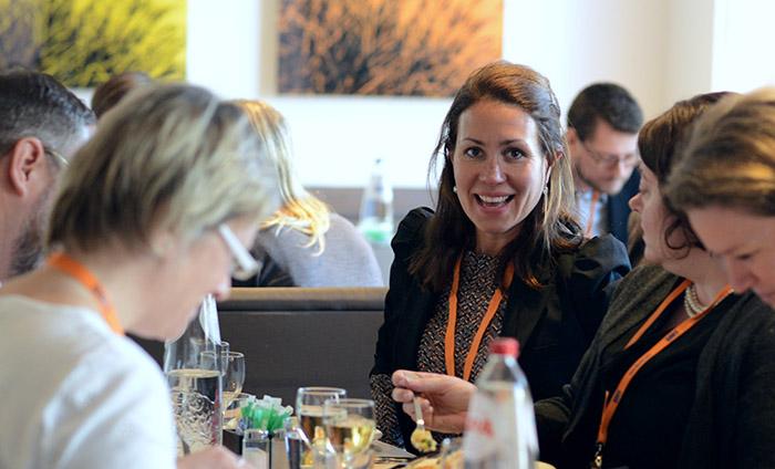 Kirsten sharing stories at Qual 360 in Europe