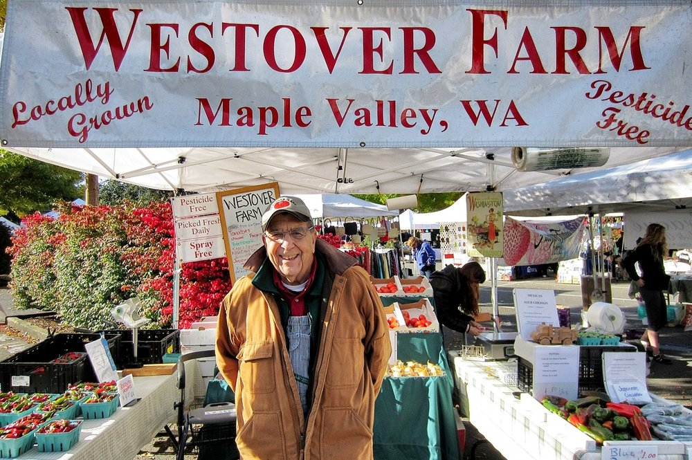 Farmer, Darrel Westover of Westover Farms in Maple Valley, WA sells his produce with a smile at the Issaquah Farmer's Market (photo credit @zoomebosh of https://zoomeboshi.com)