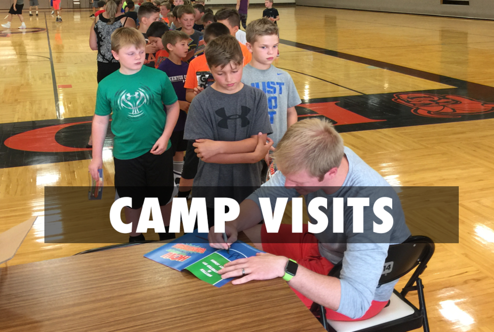 Author Corey Jones signs copies of his book, How To Shoot A Basketball at the North Canton Vikings boys basketball camp. #how2shootaBball.