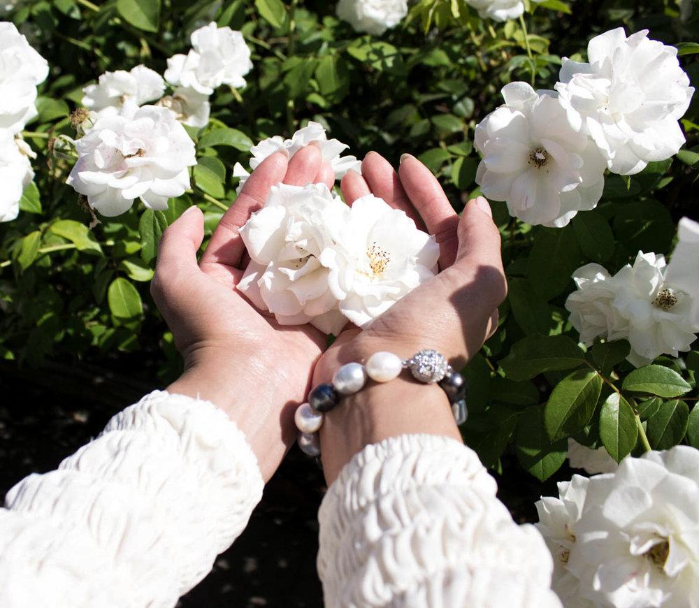 Pearl Rack_Hand Holding Flower.jpg