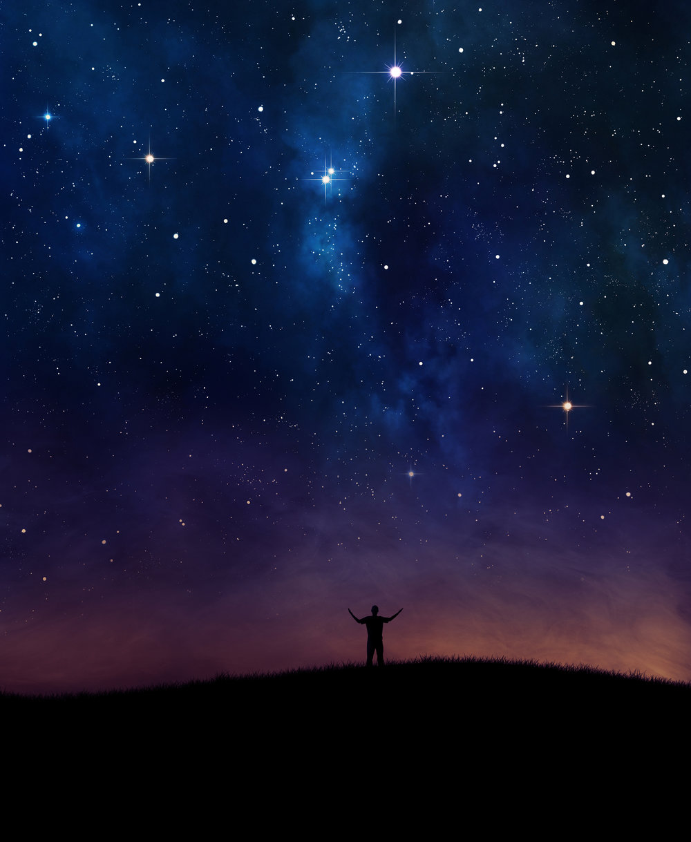 man-lifting-hands-under-night-sky.jpg