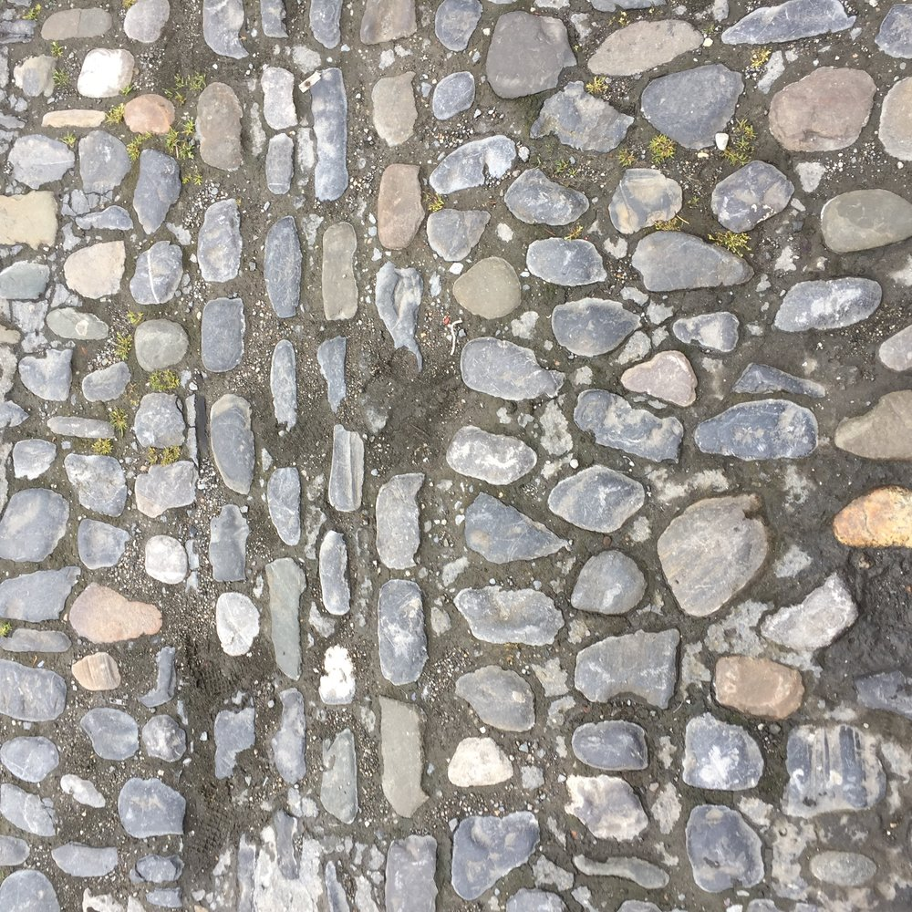 Walking on cobblestones made for tired feet.
