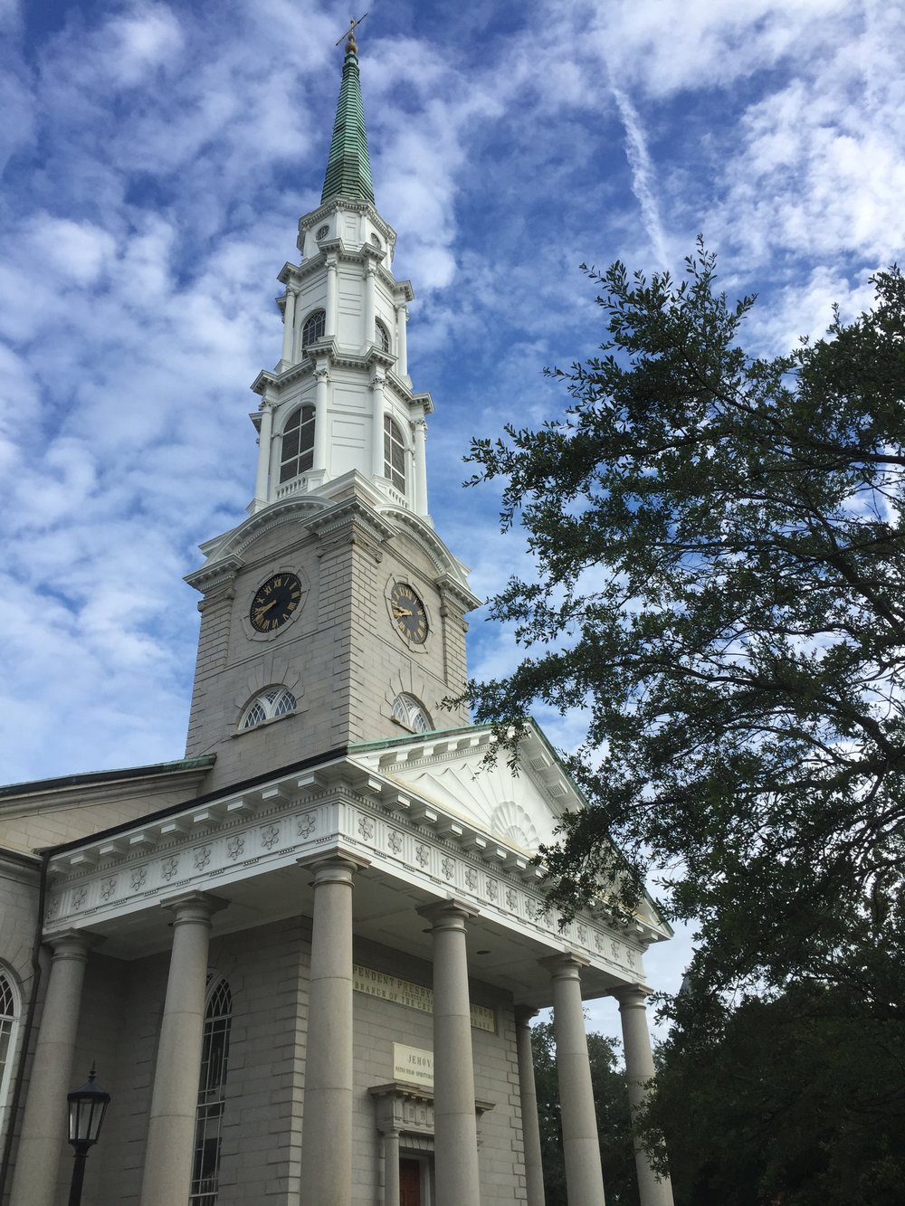 Looking up at the Independent Presbyterian Church in Savannah and finding more than I expected. I love the cloudy blue sky, the verdigris steeple, and the jet stream that mirrors it.