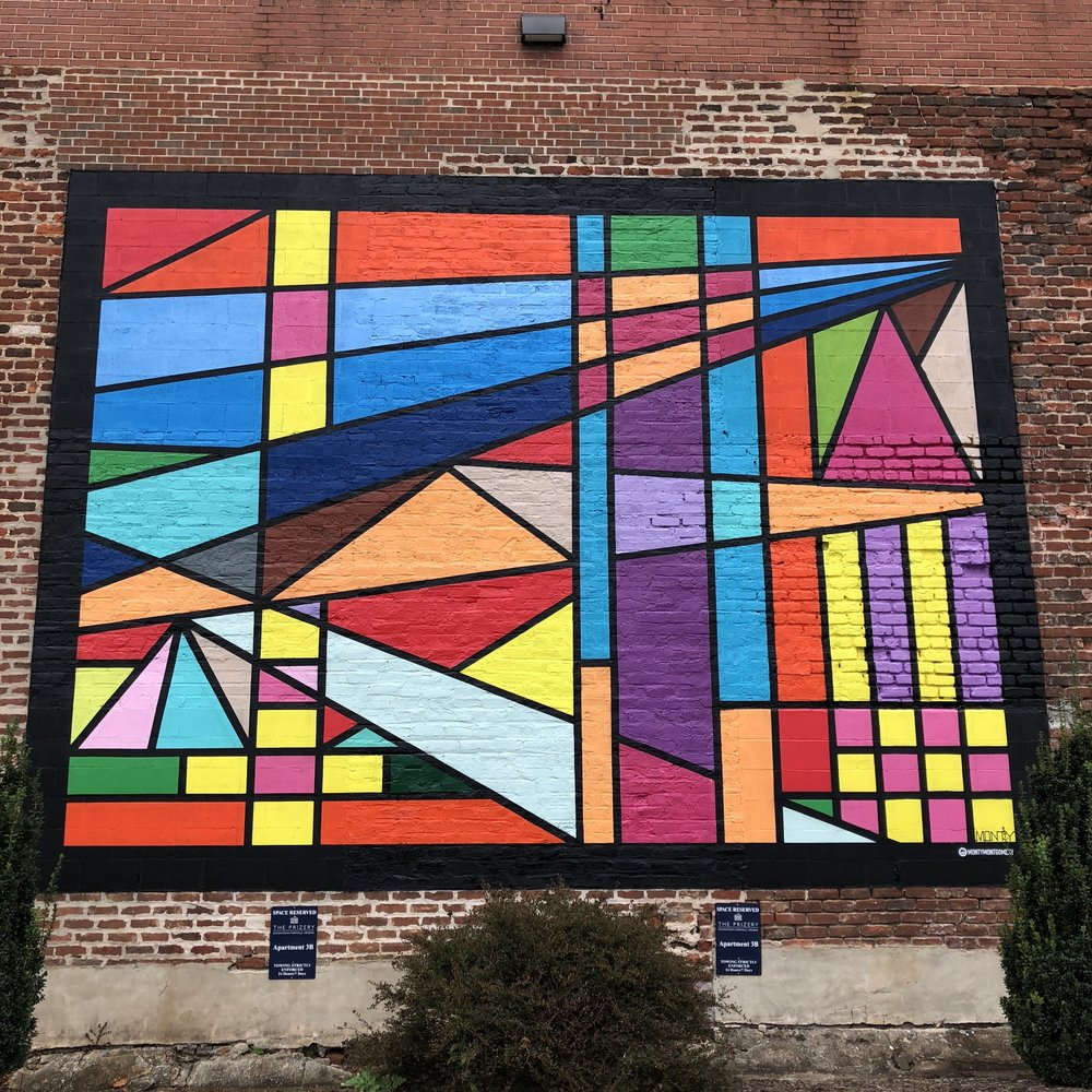 One of three outdoor murals by artist Monty Montgomery. They form the backdrop for the weekly Farmers' Market.
