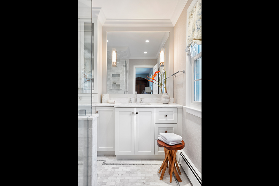 By changing out the enclosed shower wall for glass, Giselle immediately opened up the bath to more light and space.