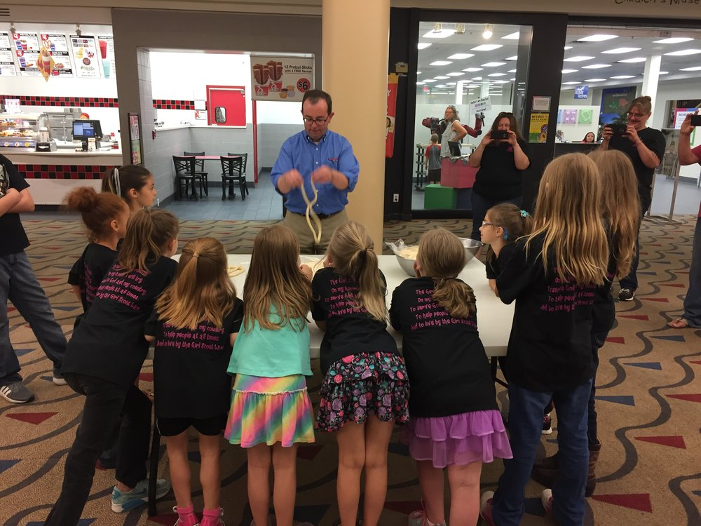 Kevin Krabill demonstrating how to make a twist pretzel to the Girl Scouts in Findlay, OH. -
