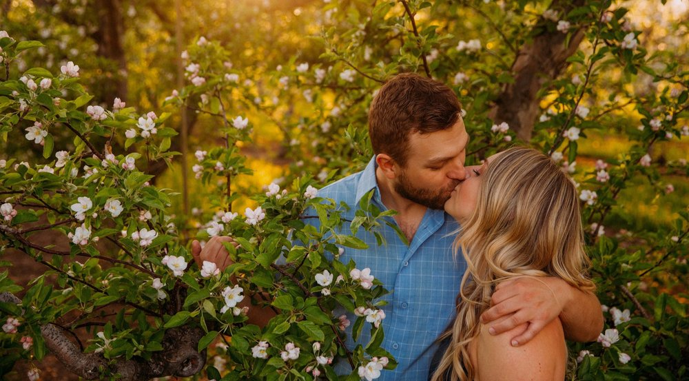 Spring engagement in the orchards of Kelowna.