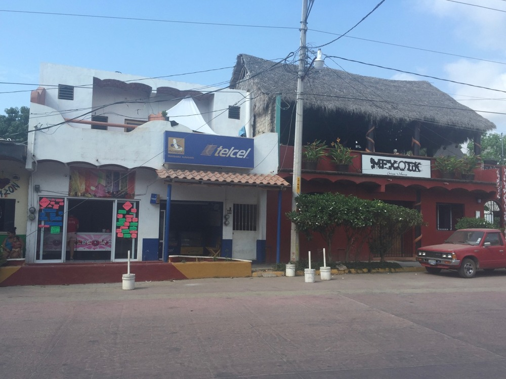 There's the Telcel store, right across the street from the community center on the main road, Avenue Tercer Mundo.