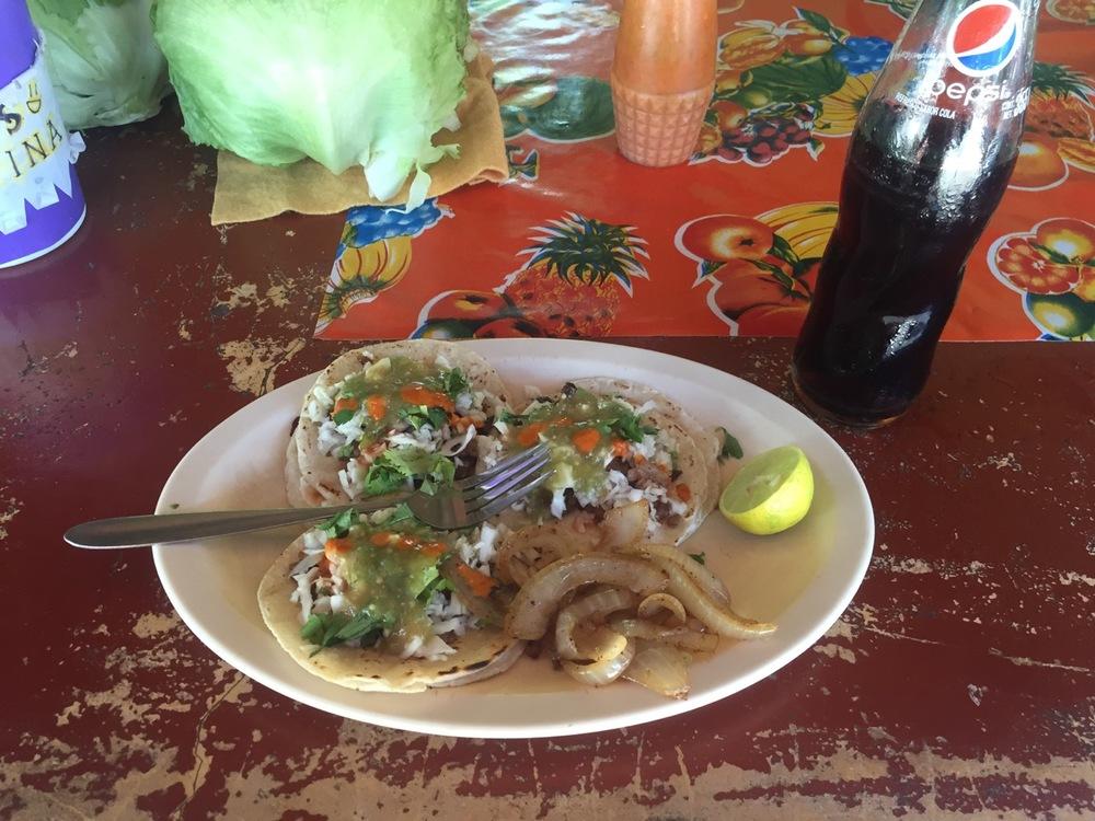 Tres tacos - asada tacos, mind you - y una Pepsi.