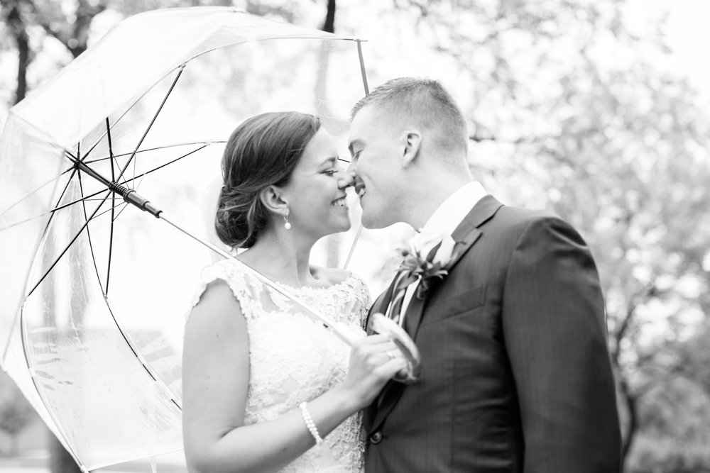 The High Point Malvern PA Wedding Photography Bride and Groom Kissing under an umbrella