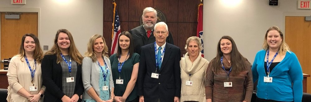 New CASA Volunteers Megan Sooter, Molly Hester, Holly Bruns, Ivy Farrow, Jack Sills, Michele Sowers, Samantha Dinwiddie, and Jessica Burnett with Judge Tim Irwin