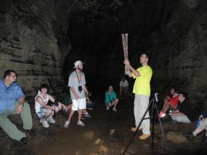 Dr. Leider demonstrates sound dynamics by measuring impulse responses in a lava cave by recording the slap impact of two pieces of wood. Photo by Joseph B. Treaster