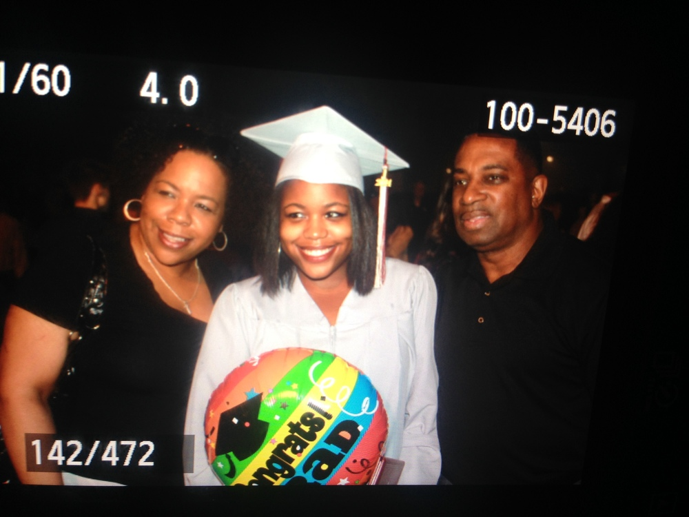 photo by heythats jaz --- My parents and I at my graduation in May 2014