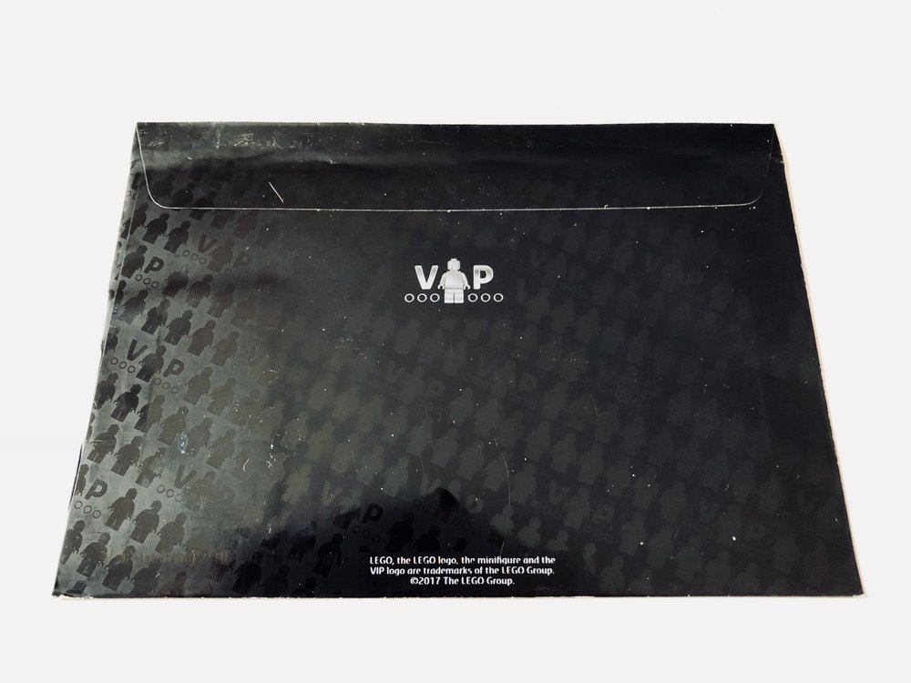 The back of the envelope continues the repeating VIP pattern and glossy black coding