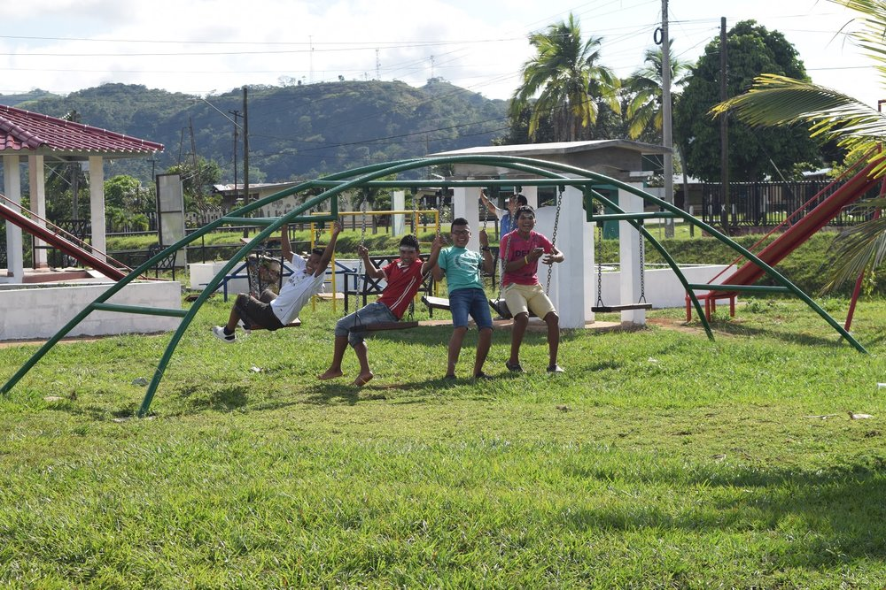 Youth from Quebrada Honda relaxing in the park across the street between sessions during Panama Camp 2018.