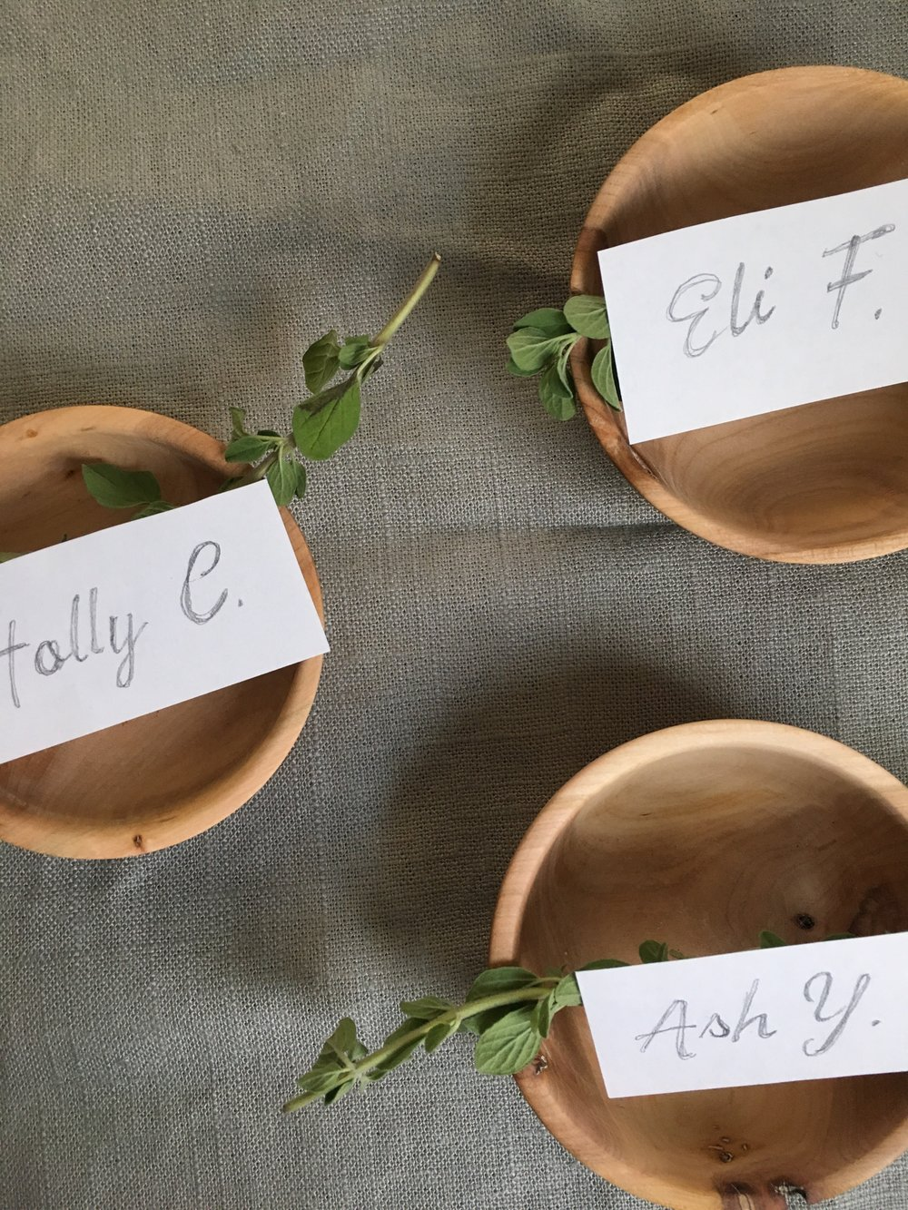 simple thanksgiving place setting using handmade wooden pinch pot and herbs