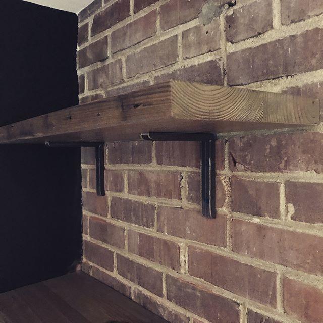 A few shelves and custom brackets for Kenny's Bar. #reclaimedwood #metalwork #brickwall #atlanta