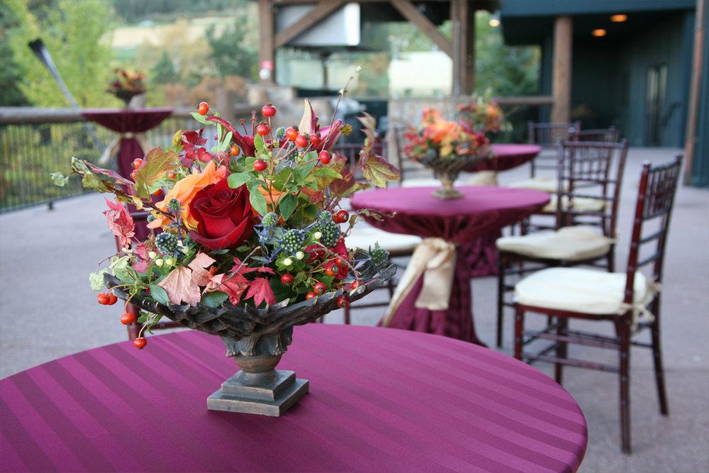textured-wild-centerpieces-red-roses-juliet-garden-roses-artichoke-burgundy-peonies.jpg