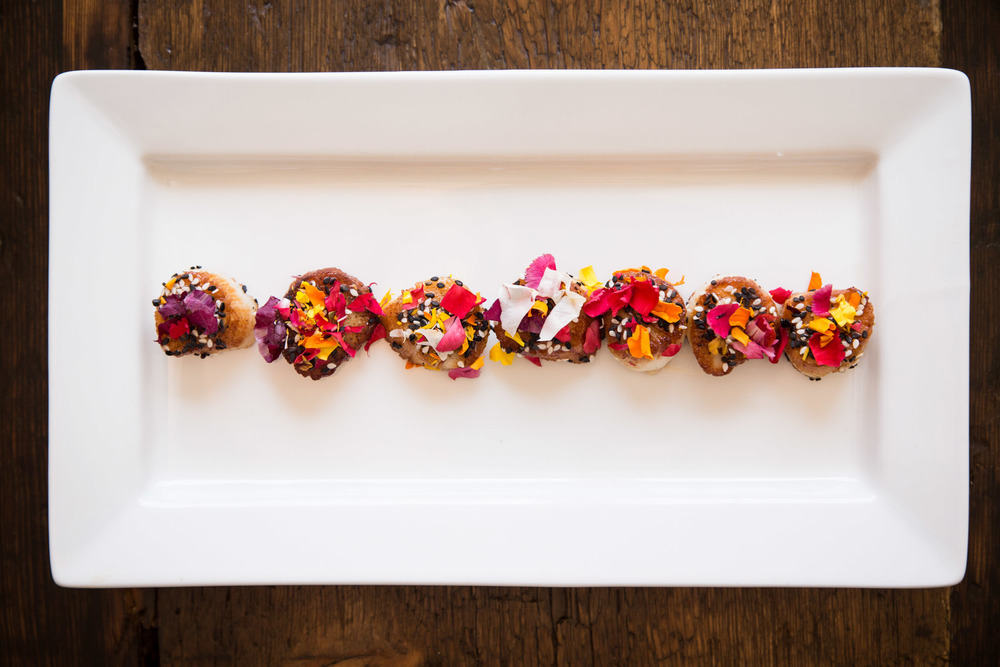 Sesame-Seared Scallop with Blueberry Gastrique and Edible Flowers
