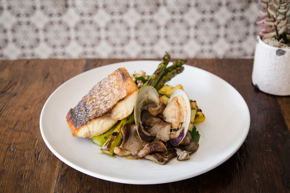 Crispy-Skin Striped Bass topped with a Leek, Wellfleet Clam, Vermouth, and Wild Mushroom Sauce