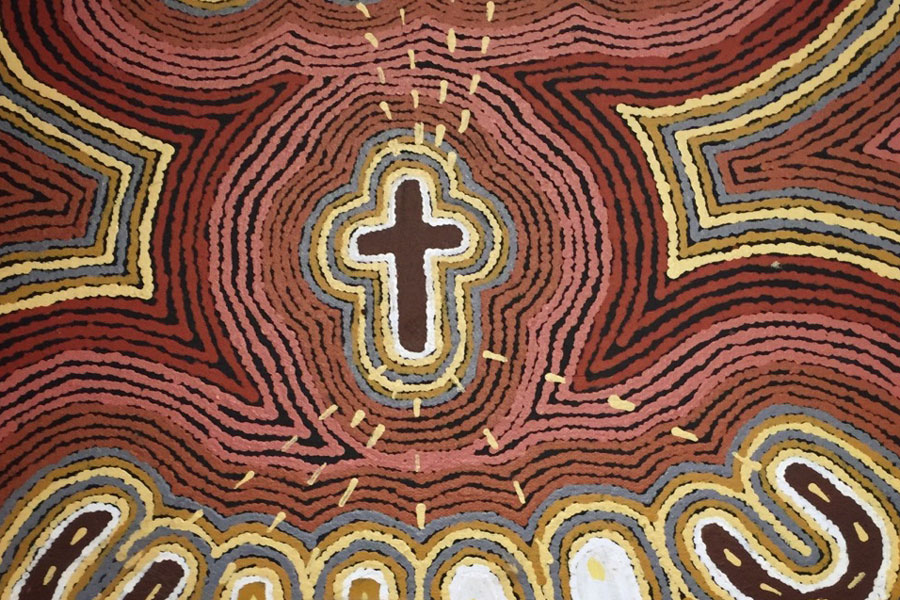 Pictured: A beautiful expression of the the Cross in traditional Aboriginal art on display at the Kidman Street Church, Alice Springs.