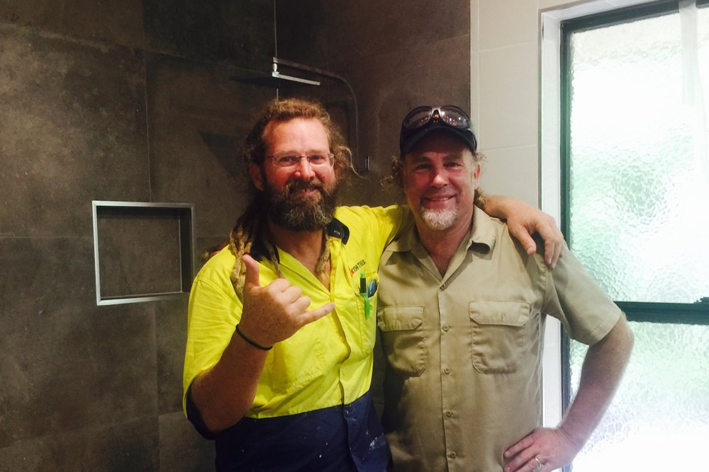 Pictured: Dave Ison with Steve and the beautifully renovated bathroom at home.