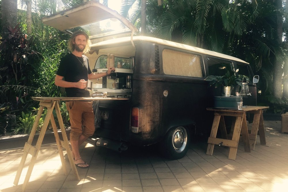 Pictured: Cheyne Grace at work with the Kombi Cafe at Eastgate Church in Byron Bay.