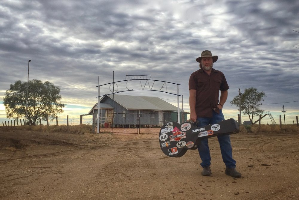 Pictured: Steve with guitar at the old Morella CWA Hall north of Longreach, Queensland