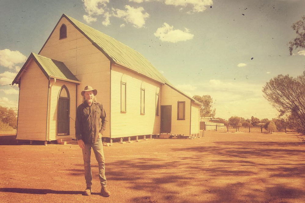 Pictured: Steve outside a historic church in a town called Sandstone, Western Australia
