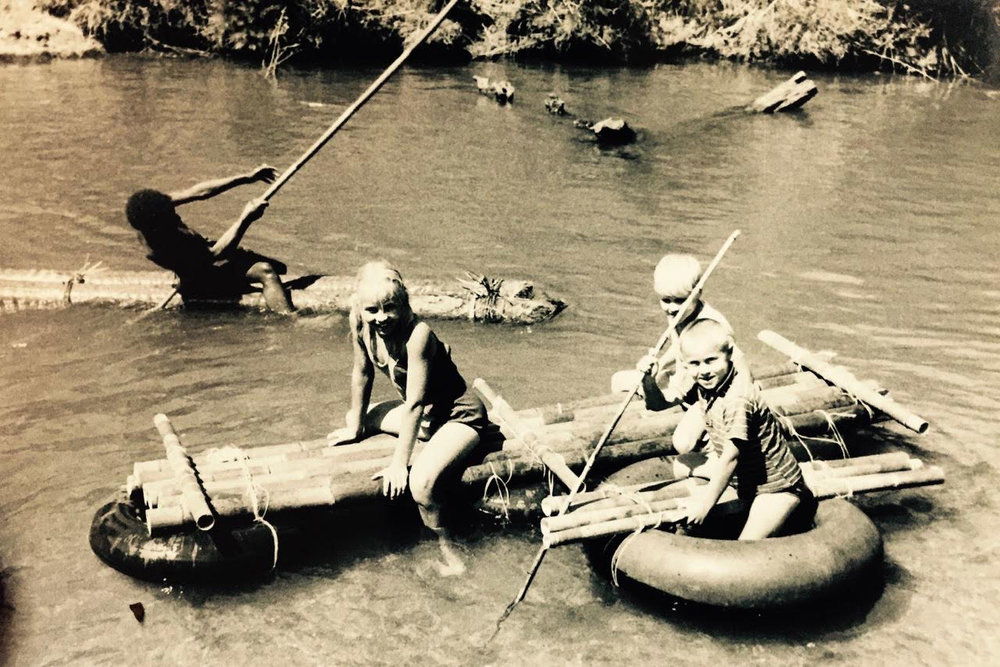 Pictured: The Grace kids on their maiden voyage aboard a newly constructed raft in Ukarumpa, Papua New Guinea, Circa 1968.