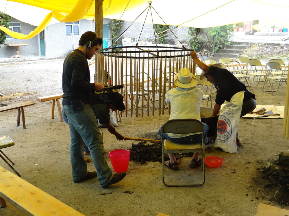 Daniel Quintanills filming preparations for religious festival in Totontepec.