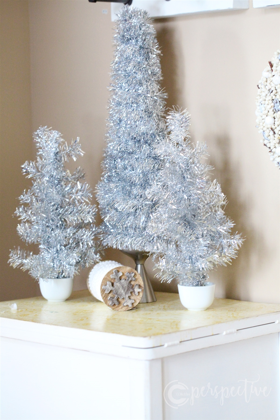tinsel trees in glass holders