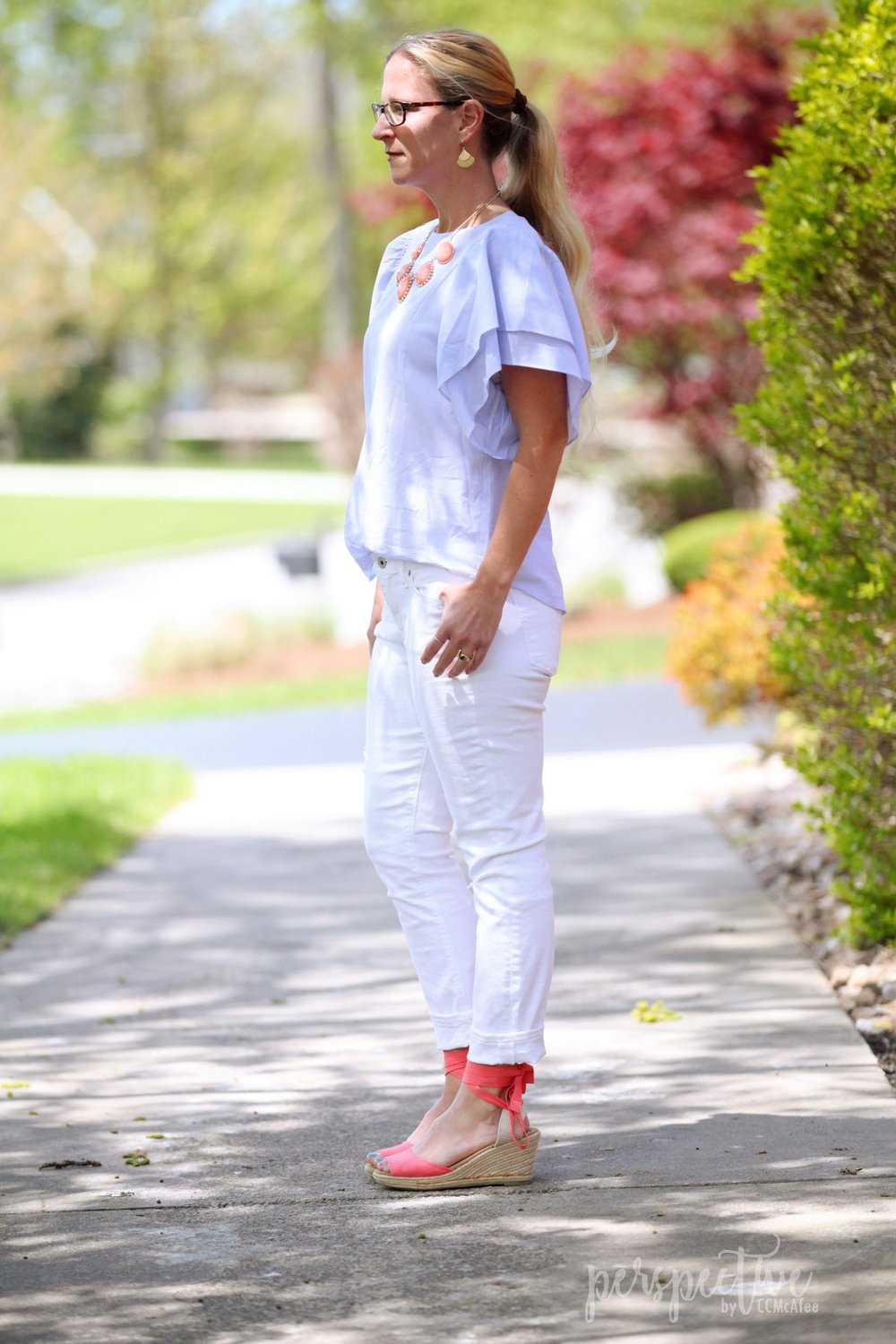 white pants and flutter sleeve top