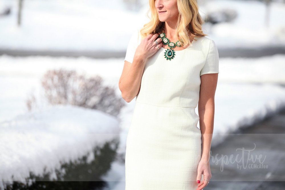 white dress emerald necklace