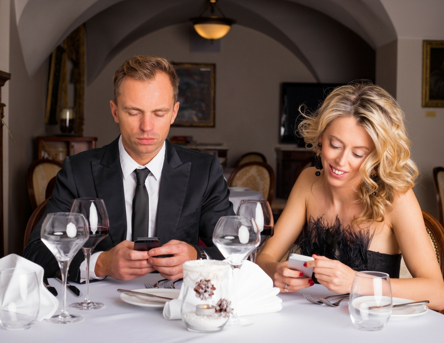 couple on their phones