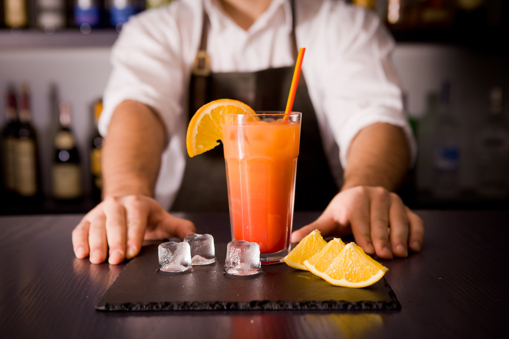 Man with orange cocktail.jpg