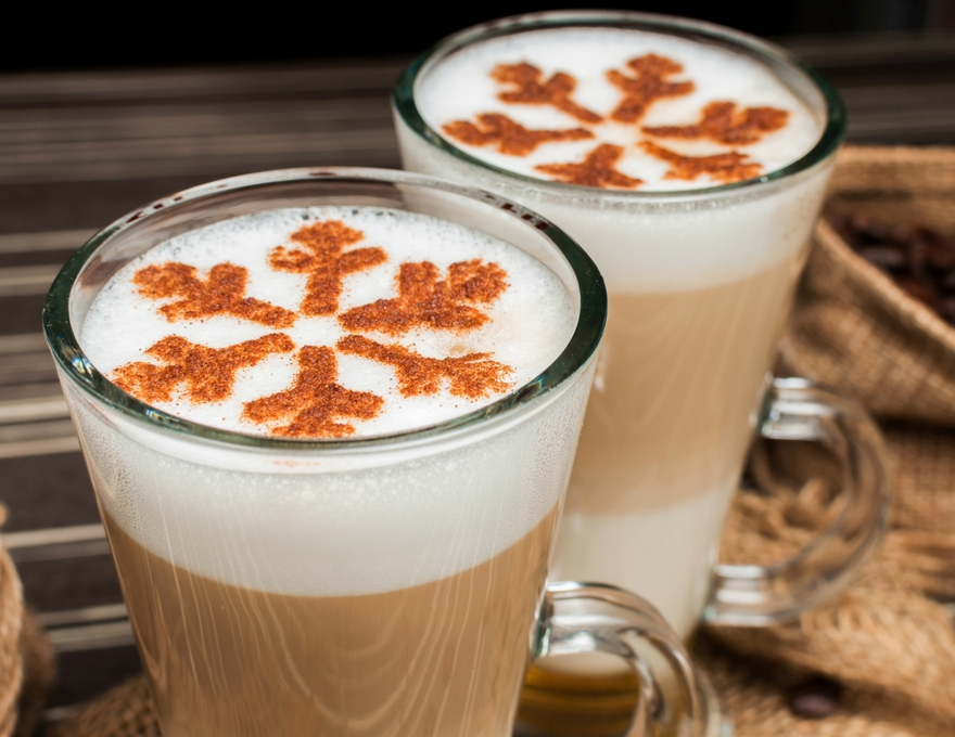 festive latte with snowflake coffee art.jpg