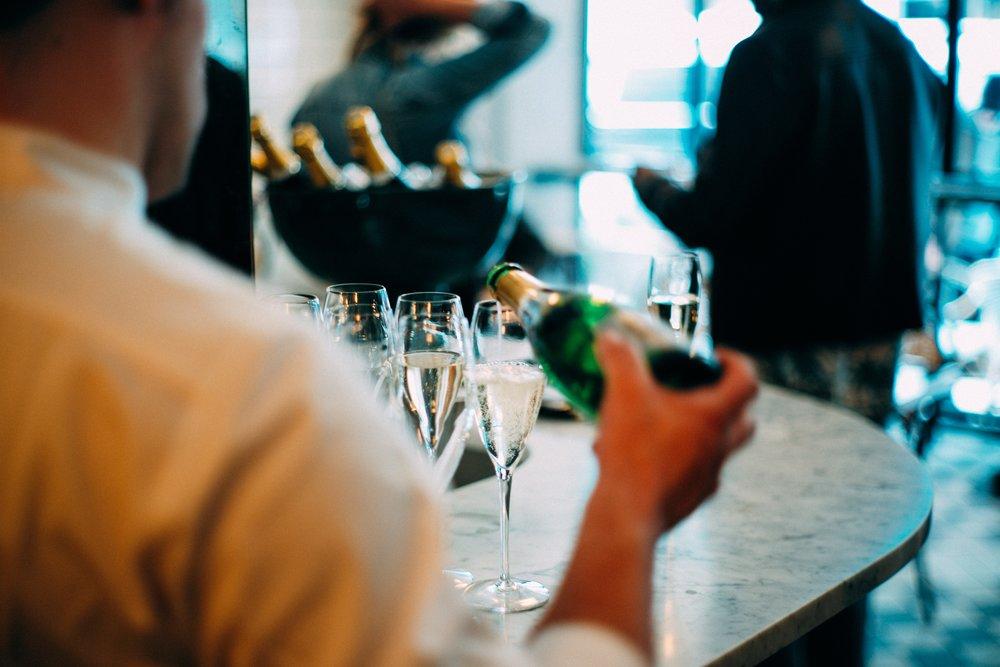 Person pouring champagne