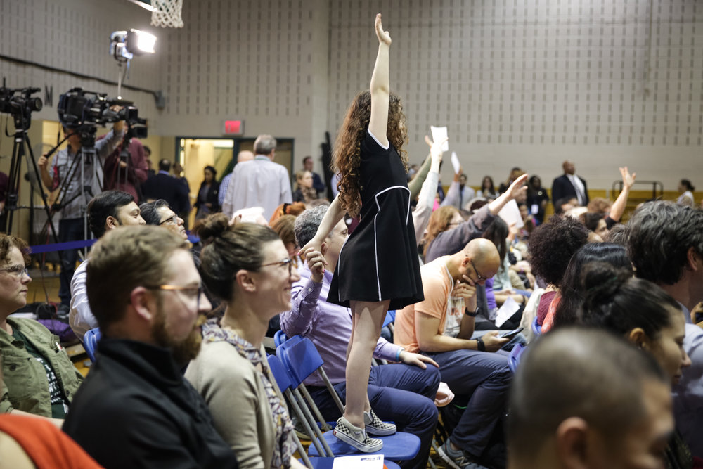 A young community member raised her hand to ask a question during a town hall hosted by Mayor Bill de Blasio and Council Member Jimmy Van Bramer in Queens, New York on April 27th, 2017. ( For   New York City Mayor's Office)