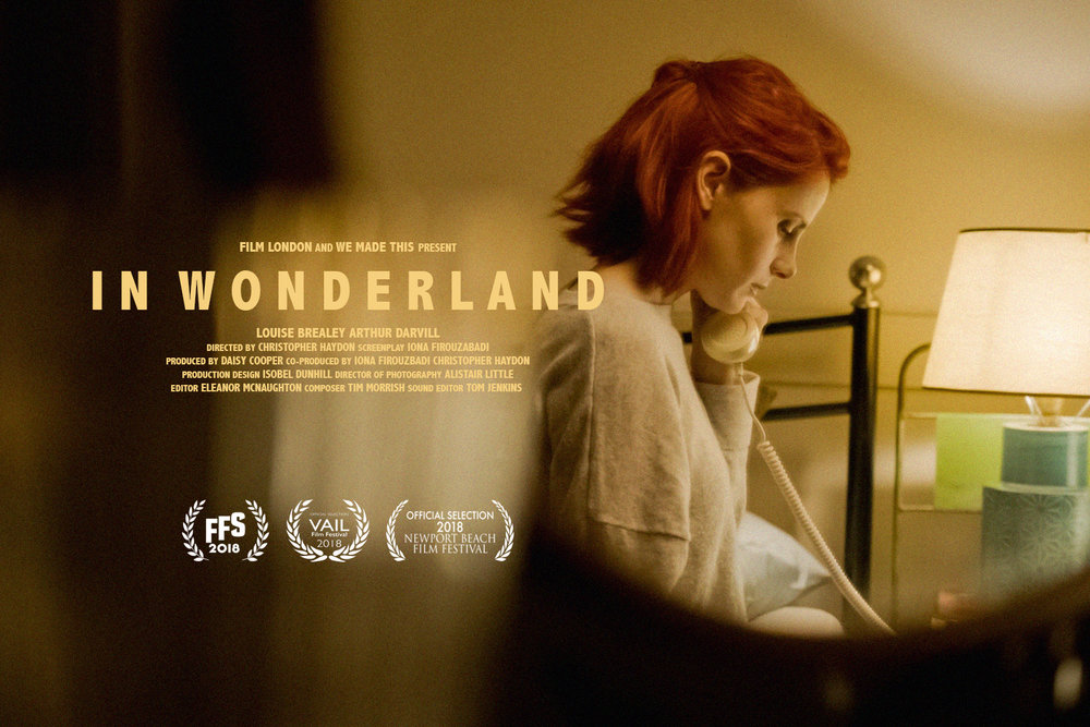 In+Wonderland+poster+with+laurels+Website+March.jpg