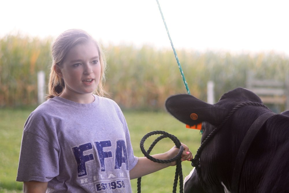 FFA members from East and West Holmes schools play a vital role in helping with the farm tour, and they also sponsor the tour's poster contest each year.