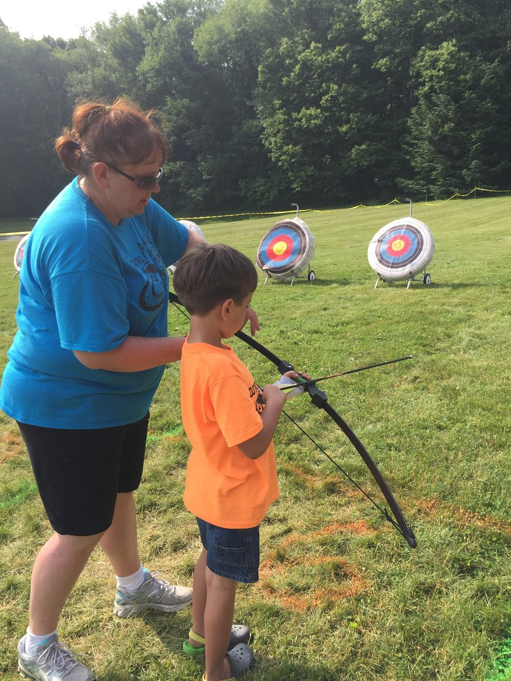 My youngest sometimes struggles with both fine and gross motor skills, but what could be more fun than becoming an archery master in training?
